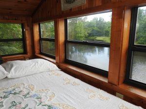 Bed overlooking lake